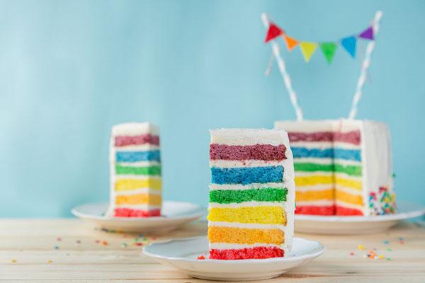 96197905 Birthday Background Striped Rainbow Cake With White